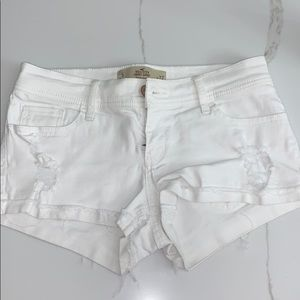 White Hollister Jean Shorts with rips